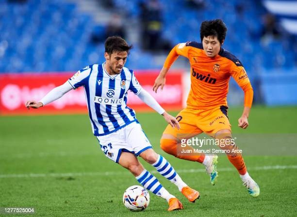 David Silva of Real Sociedad duels for the ball with Kang-in Lee of Valencia CF during the La Liga Santander match between Real Sociedad and Valencia...