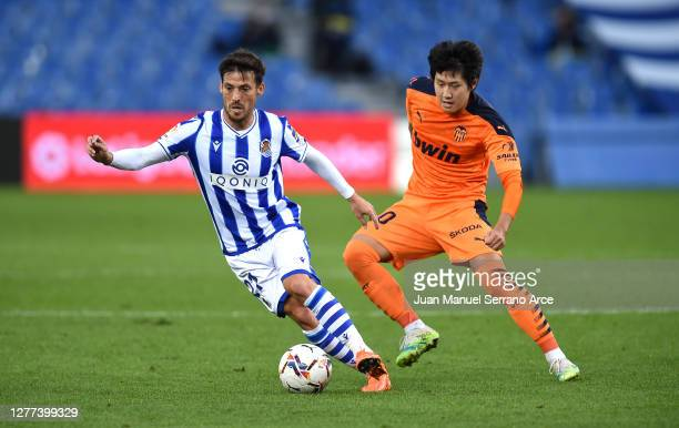 David Silva of Real Sociedad is challenged by Lee Kang-In of Valencia CF during the La Liga Santander match between Real Sociedad and Valencia CF at...