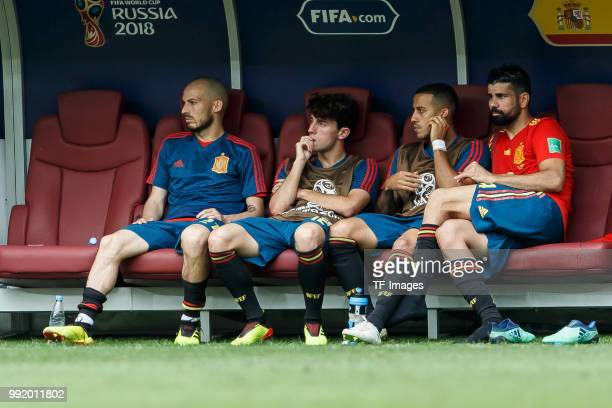 David Silva of Spain Alvaro Odriozola of Spain Thiao of Spain and Alexander Samedov of Russia sit on the bench during the 2018 FIFA World Cup Russia...