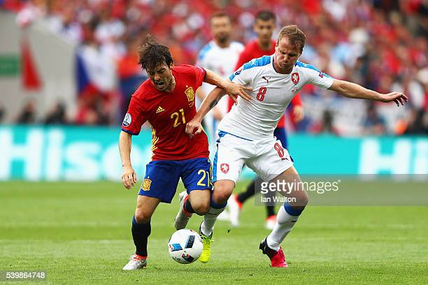 David Silva of Spain and David Limbersky of Czech Republic compete for the ball during the UEFA EURO 2016 Group D match between Spain and Czech...