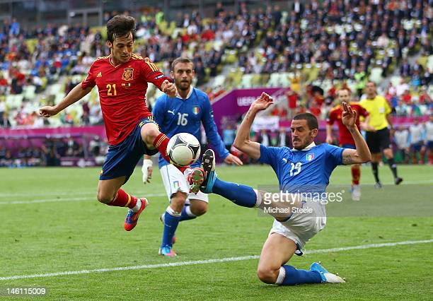 David Silva of Spain and Leonardo Bonucci of Italy compete for the ball during the UEFA EURO 2012 group C match between Spain and Italy at The...