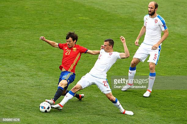 David Silva of Spain and Vladimir Darida of Czech Republic compete for the ball during the UEFA EURO 2016 Group D match between Spain and Czech...