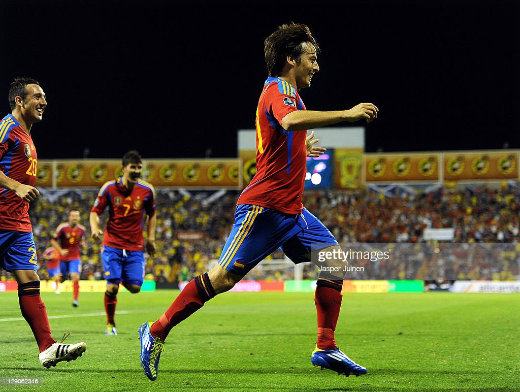 David Silva of Spain celebrates scoring his sides early opening goal during the UEFA EURO 2012 Group I Qualifier between Spain and Scotland at the Rico Perez stadium on October 11, 2011 in Alicante, Spain.