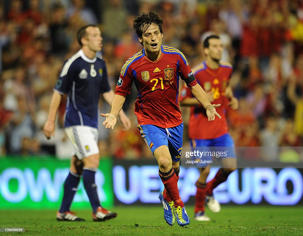 David Silva of Spain celebrates scoring his sides second goal during the UEFA EURO 2012 Group I Qualifier between Spain and Scotland at the Rico Perez stadium on October 11, 2011 in Alicante, Spain.