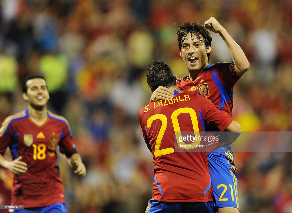 David Silva (R) of Spain celebrates scoring his sides second goal with his teammate Santi Cazorla and Pedro Rodriguez (L) during the UEFA EURO 2012 Group I Qualifier between Spain and Scotland at the Rico Perez stadium on October 11, 2011 in Alicante, Spain.
