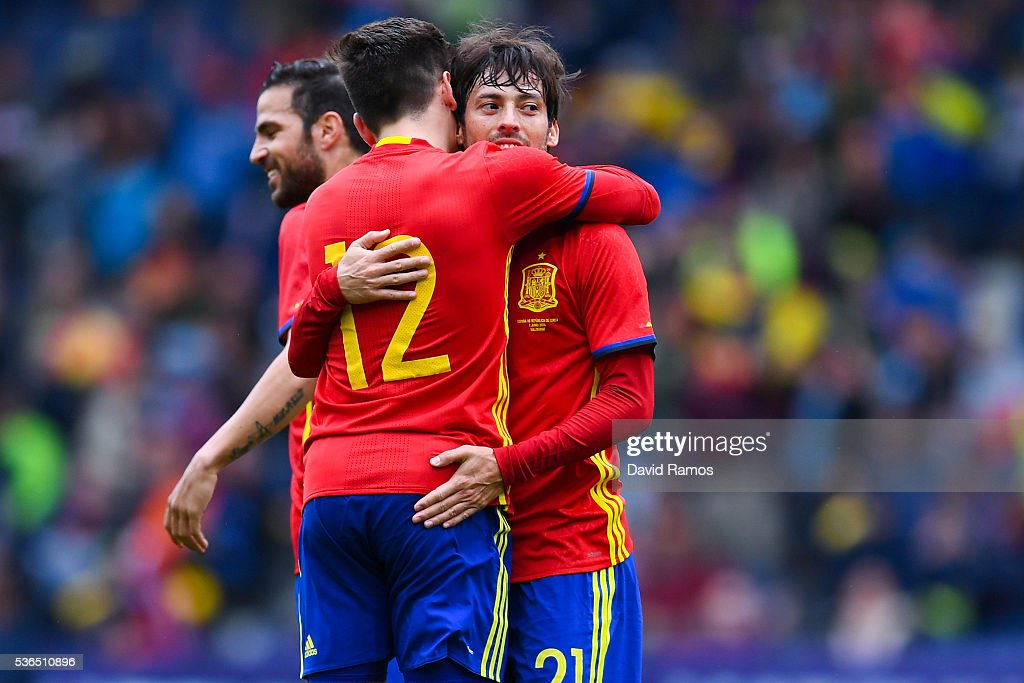 David Silva (R) of Spain celebrates with his teammates after scoring the opening goal during an international friendly match between Spain and Korea at the Red Bull Arena stadium on June 1, 2016 in Salzburg, Austria.