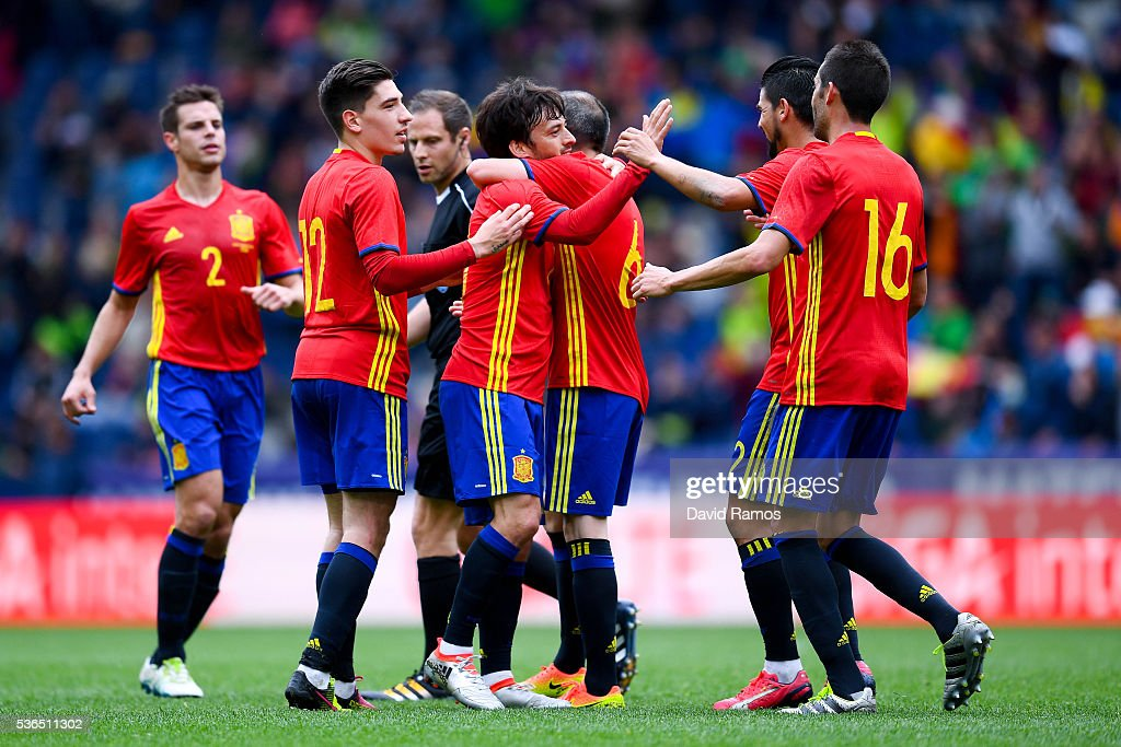 David Silva (C) of Spain celebrates with his teammates after scoring the opening goal during an international friendly match between Spain and Korea at the Red Bull Arena stadium on June 1, 2016 in Salzburg, Austria.