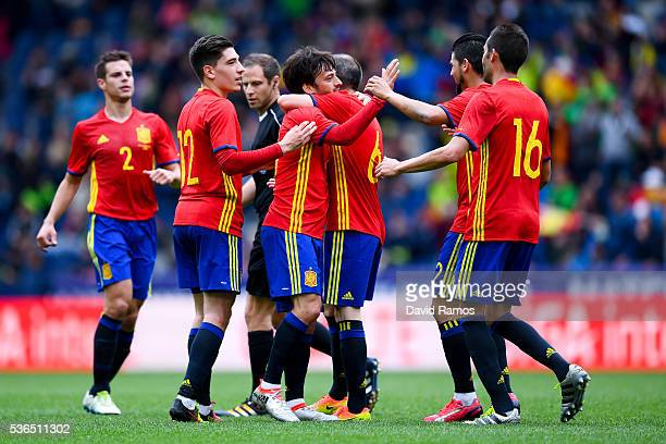 David Silva of Spain celebrates with his teammates after scoring the opening goal during an international friendly match between Spain and Korea at...