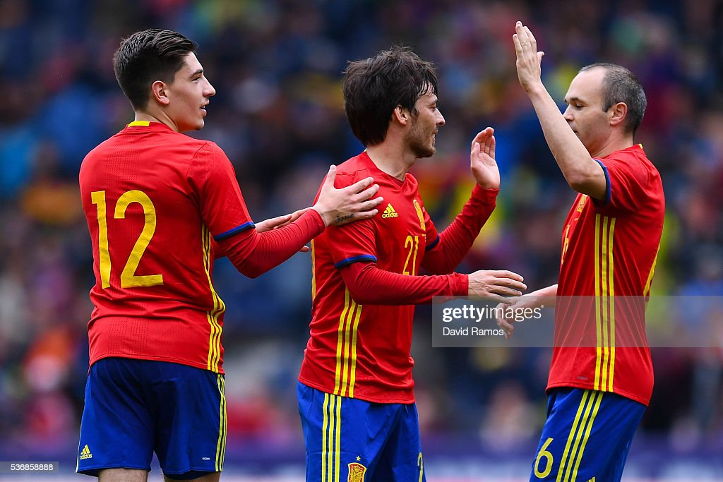 David Silva (C) of Spain celebrates with his teammates Hector Bellerin and Andres Iniesta after scoring the opening goal during an international friendly match between Spain and Korea at the Red Bull Arena stadium on June 1, 2016 in Salzburg, Austria.