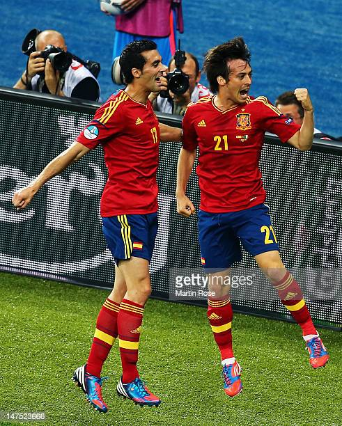 David Silva of Spain celebrates with team-mate Alvaro Arbeloa after scoring the opening goal during the UEFA EURO 2012 final match between Spain and...