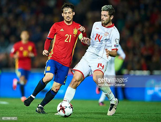 David Silva of Spain competes for the ball with Darko Velkovski of FYR Macedonia during the FIFA 2018 World Cup Qualifier between Spain and FYR...