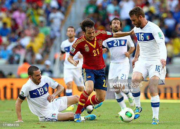 David Silva of Spain competes with Leonardo Bonucci of Italy and Daniele De Rossi during the FIFA Confederations Cup Brazil 2013 Semi Final match...