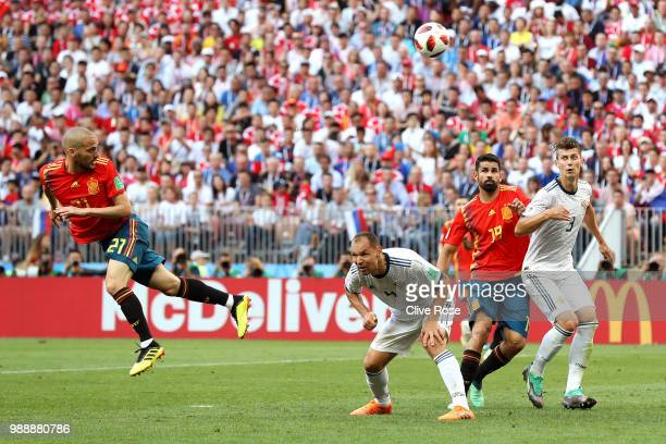 David Silva of Spain heads the ball wide during the 2018 FIFA World Cup Russia Round of 16 match between Spain and Russia at Luzhniki Stadium on July...