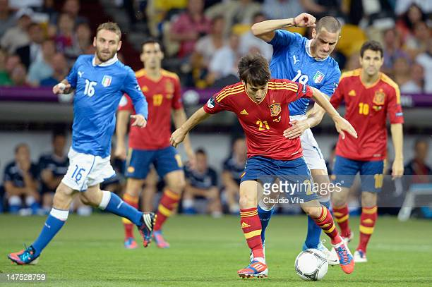 David Silva of Spain in action against Leonardo Bonucci of Italy during the UEFA EURO 2012 final match between Spain and Italy at the Olympic Stadium...