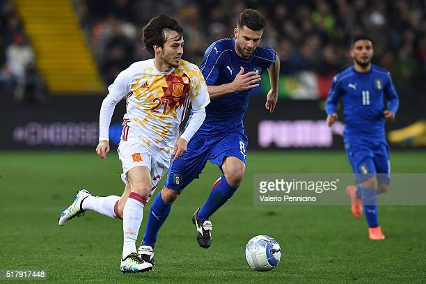 David Silva of Spain in action against Thiago Motta of Italy during the international friendly match between Italy and Spain at Stadio Friuli on...