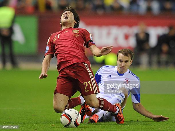 David Silva of Spain is fouled by Lars Gerson of Luxembourg during the UEFA EURO 2016 Qualifier group C match between Spain and Luxembourg at Estadio...