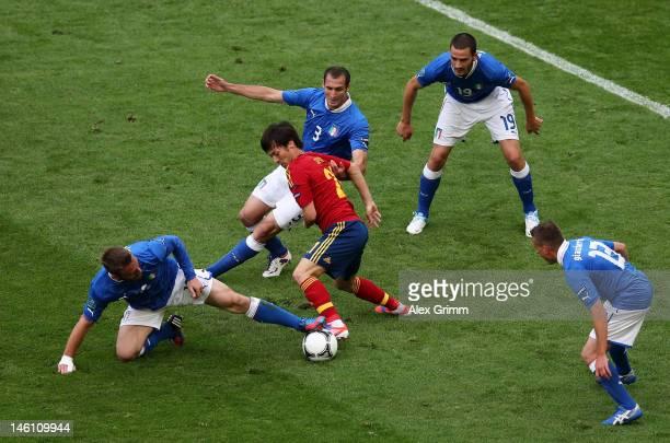 David Silva of Spain is marshalled by Daniele De Rossi Giorgio Chiellini Leonardo Bonucci and Emanuele Giaccherini of Italy during the UEFA EURO 2012...