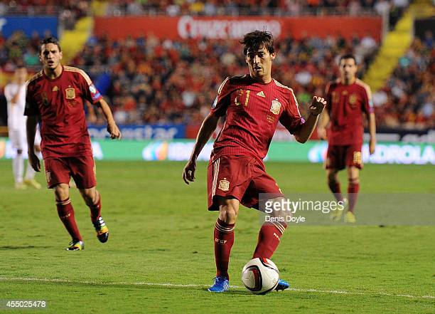 David Silva of Spain lays on a pass during the UEFA EURO 2016 Group C Qualifier between Spain and FYR of Macedonia at Estadio Ciutat de Valencia on...