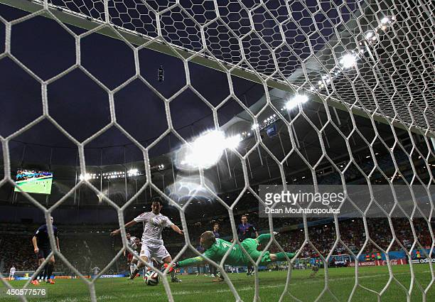 David Silva of Spain scores past Jasper Cillessen of the Netherlands but the goal was disallowed during the 2014 FIFA World Cup Brazil Group B match...