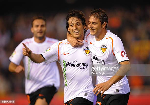 David Silva of Valencia celerbrates with Joaquin Sanchez after scoring his team's second goal during the La Liga match between Valencia and Real...