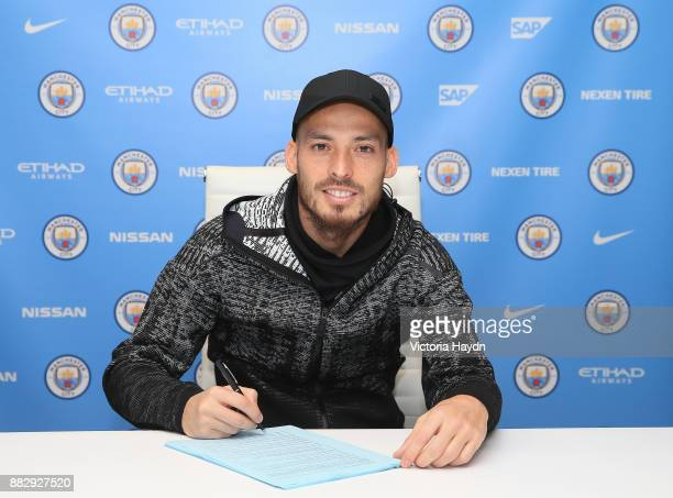 David Silva poses as he signs a new contract at Manchester City Football Academy on November 30 2017 in Manchester England