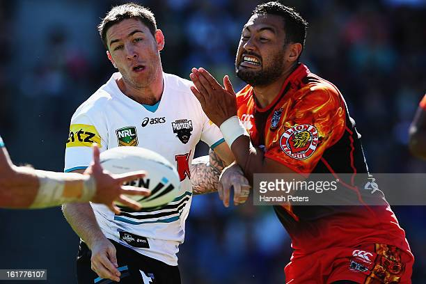 David Simmons of the Panthers clashes with Feleti Mateo of the Warriors during the NRL trial match between the New Zealand Warriors and the Penrith...