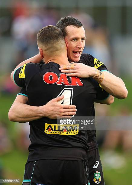 David Simmons of the Panthers hugs team mate Lewis Brown at full time following the round 26 NRL match between the Penrith Panthers and the Newcastle...