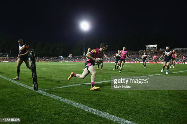 David Simmons of the Panthers scores a try during the round 16 NRL match between the Wests Tigers and the Penrith Panthers at Leichhardt Oval on June...