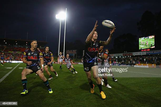 David Simmons of the Panthers stretches to catch the ball during the round 23 NRL match between the Penrith Panthers and the New Zealand Warriors at...
