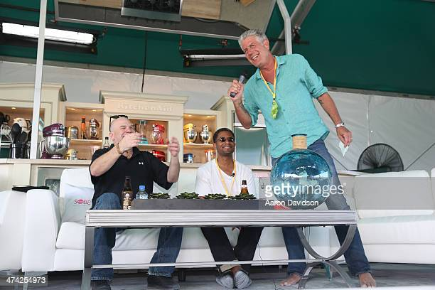 David Simon Lolis Elie and Chef Anthony Bourdain speak onstage at the KitchenAid® Culinary Demonstrations during the Food Network South Beach Wine...