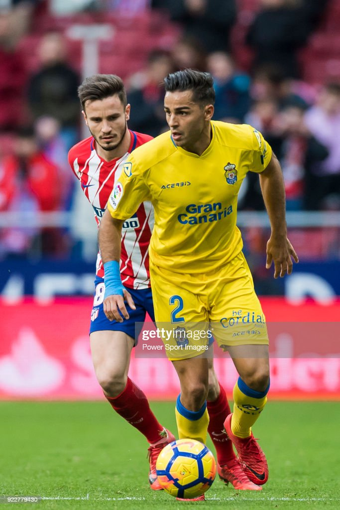 David Simon (R) of UD Las Palmas battles for the ball with Saul Niguez Esclapez of Atletico de Madrid during the La Liga 2017-18 match between Atletico de Madrid and UD Las Palmas at Wanda Metropolitano on January 28 2018 in Madrid, Spain.