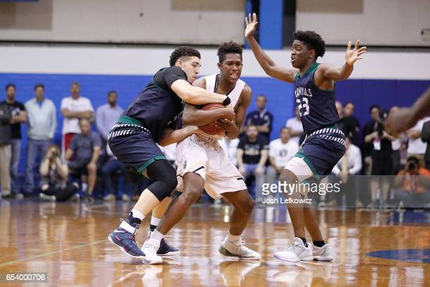 David Singleton of Bishop Montgomery High School and LiAngelo Ball of Chino Hills High School fight for possession of the ball during the game...