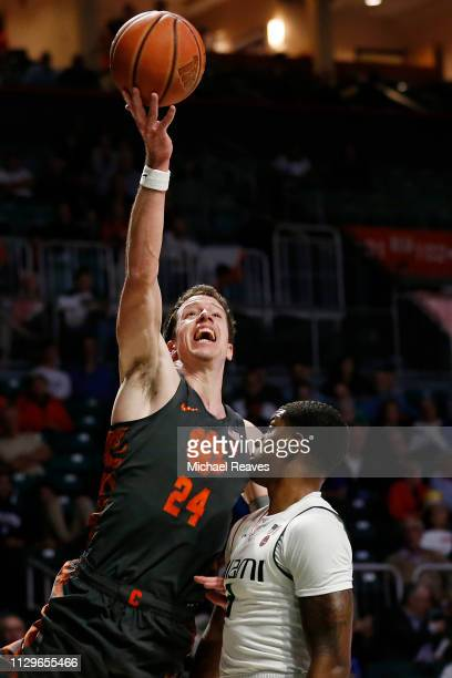 David Skara of the Clemson Tigers shoots over Anthony Lawrence II of the Miami Hurricanesduring the first half at the Watsco Center on February 13...