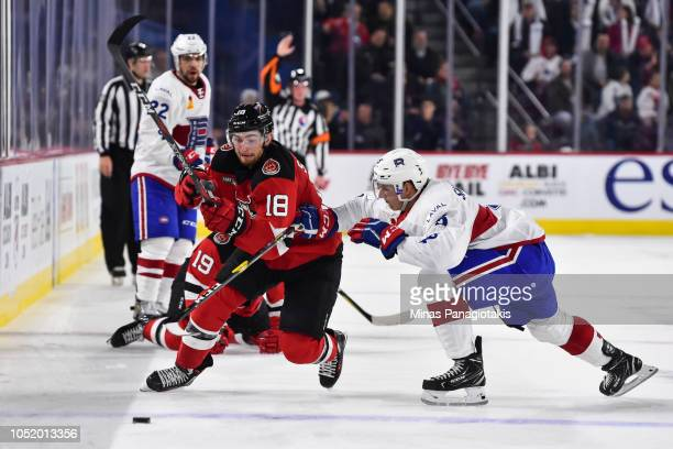 David Sklenicka of the Laval Rocket challenges Blake Speers of the Binghamton Devils during the AHL game at Place Bell on October 12 2018 in Laval...