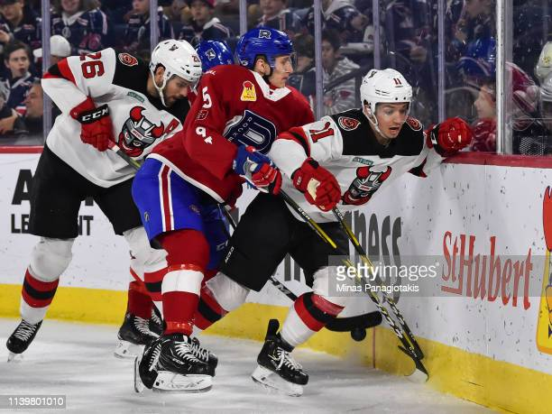 David Sklenicka of the Laval Rocket pins Brett Seney of the Binghamton Devils against the boards during the AHL game at Place Bell on March 27 2019...