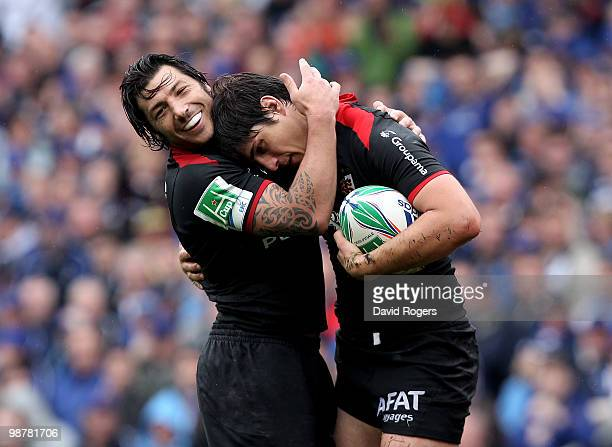 David Skrela of Toulouse is congratulated by team mate Byron Kelleher after scoring the second try during the Heineken Cup semi final match between...