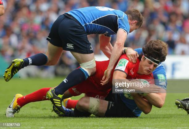 David Skrela of Toulouse is tackled by Brian O'Driscoll and Jamie Heaslip during the Heineken Cup semi final match between Leinster and Toulouse at...