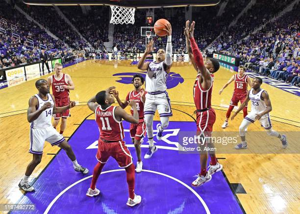 David Sloan of the Kansas State Wildcats drives in for a basket against De'Vion Harmon of the Oklahoma Sooners during the first half at Bramlage...