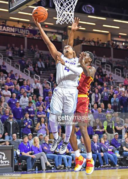 David Sloan of the Kansas State Wildcats drives in for a lay up against Nate Jenkins of the Iowa State Cyclones during the second half at Bramlage...