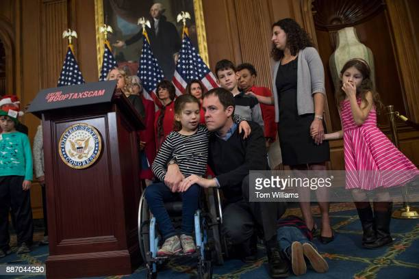 David Smith and his daughter Claire attend a news conference with House Minority Leader Nancy Pelosi DCalif MomsRising and other members in the...