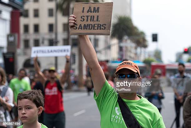 David Smith holds a sign during Enough is Enough protest in Los Angeles California August 27 2016 People gathered to protest a variety of issues...