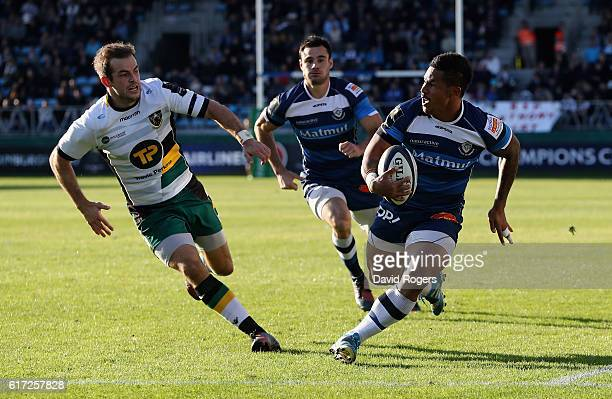 David Smith of Castres breaks clear of Stephen Myler to score their third try during the European Rugby Champions Cup match between Castres and...