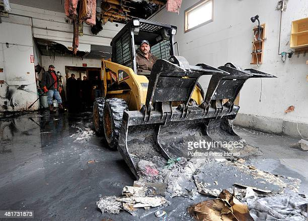 David Smith, owner of Town and Country Cabinets in Gorham, surveys the damage to his business following a fire on Tuesday morning. Troy Pride, a...