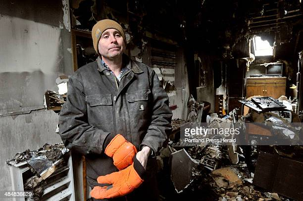 David Smith, owner of Town and Country Cabinets in Gorham, surveys the damage to his business following a fire on Tuesday morning. Wednesday, March...