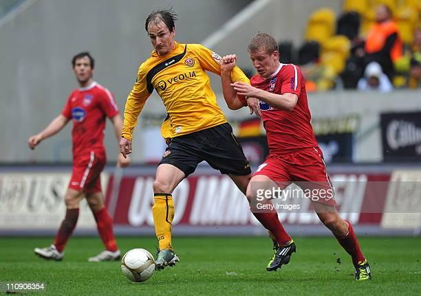 David Solga of Dresden and Richard Weil of Heidenheim during the Third League match between Dynamo Dresden and 1. FC Heidenheim at the Rudolf Harbig...