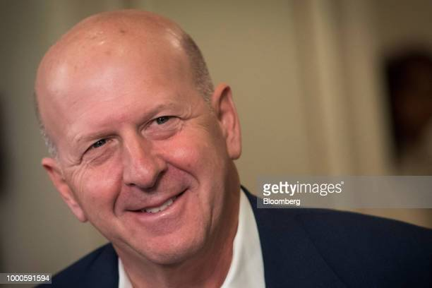 David Solomon copresident and cochief operating officer of Goldman Sachs Group Inc smiles during a Bloomberg Television interview at the Goldman...
