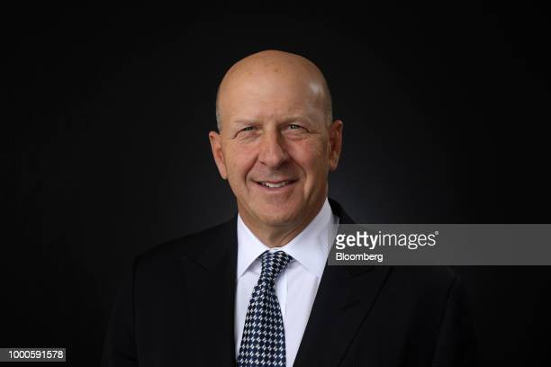 David Solomon president and cochief operating officer of Goldman Sachs Co poses for a photograph following a Bloomberg Television interview at the...