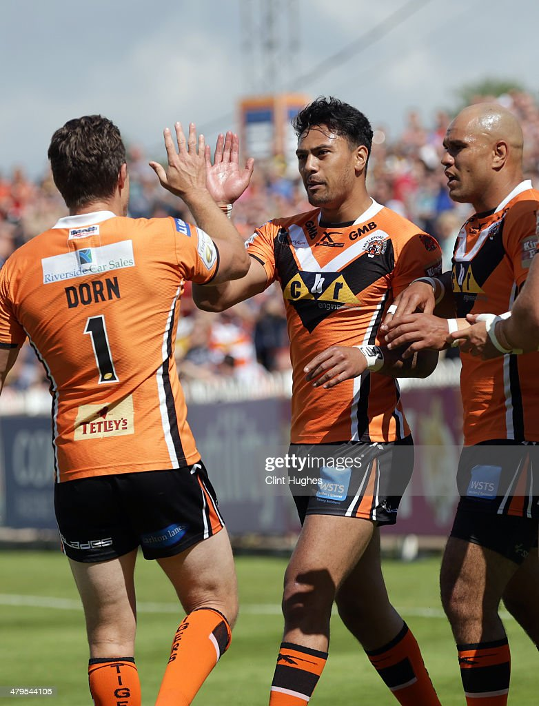 David Solomona (C) of Castleford Tigers celebrates with team-mate Luke Dorn (R) after he scores the first try for his side during the First Utility Super League match between Castleford Tigers and Widnes Vikings at The Jungle on July 5, 2015 in Castleford, England.