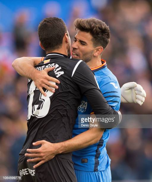 David Soria of Getafe celebrates with Leandro Cabrera of Getafe after his side scored their first goal during the La Liga match between Getafe CF and...