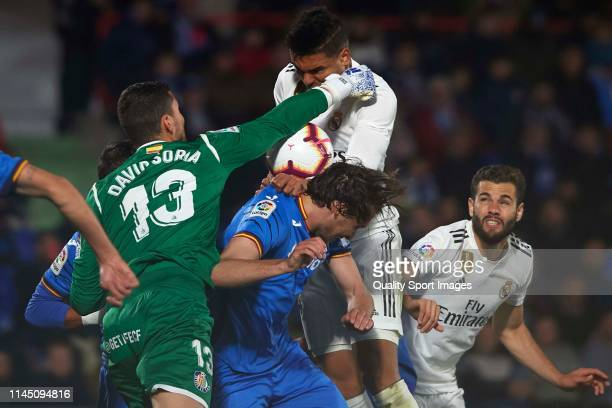 David Soria of Getafe CF competes for the ball with Casemiro of Real Madrid during the La Liga match between Getafe CF and Real Madrid CF at Coliseum...